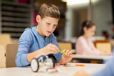 close up of boy building robot at robotics school Stock Photo