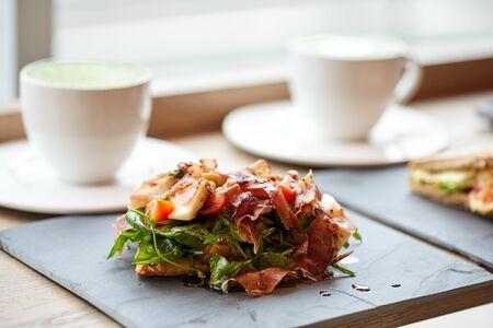 prosciutto ham salad on stone plate at restaurant