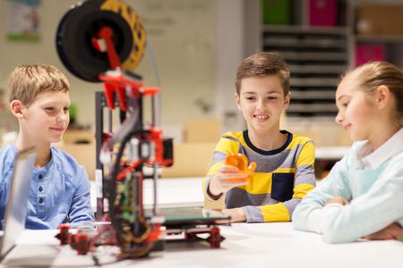 3d printer: happy children with 3d printer at robotics school Stock Photo
