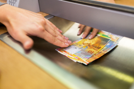 clerk giving cash money to customer at bank office Stock fotó