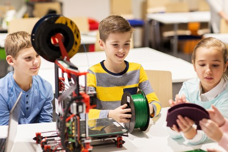 3d: happy children with 3d printer at robotics school Stock Photo