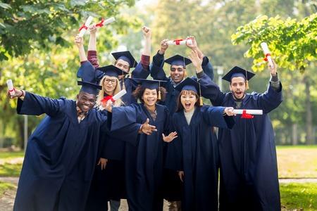 卒業証書とモルタル板で幸せな学生 写真素材