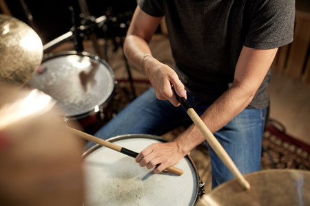 cymbal: male musician playing drums and cymbals at concert