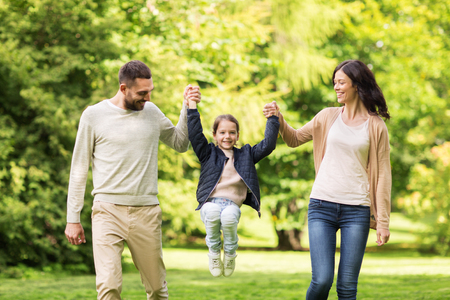happy family walking in summer park and having fun