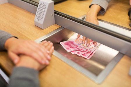 clerk giving cash money to customer at bank office Stock Photo