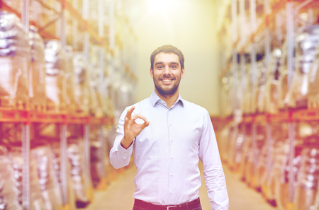 happy man at warehouse showing ok gesture Stock Photo