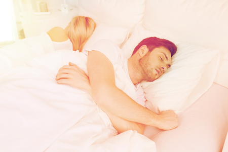 lovers quarrel: couple sleeping in bed at home Stock Photo