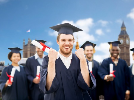 uk: happy student with diploma celebrating graduation