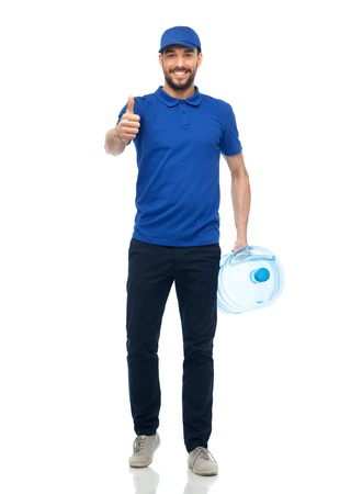 delivery service, gesture and people concept - happy man or courier with bottle of water Stok Fotoğraf