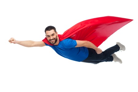 flying man: happy man in red superhero cape flying on air