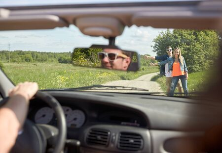 hitched: couple hitchhiking and stopping car on countryside