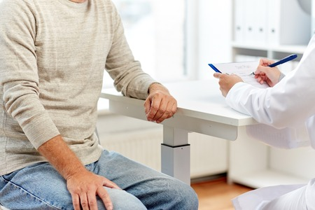 gastroenterologist: close up of senior man and doctor at hospital