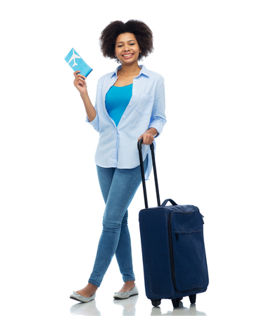 happy woman with airplane ticket and travel bag