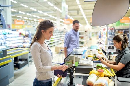 couple buying food at grocery store cash register Stock Photo