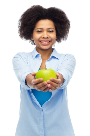 nosh: happy african american woman with green apple