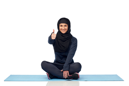 muslim woman doing sport and showing thumbs up Stock Photo