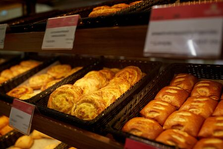 multiple objects: close up of buns at bakery or grocery store Stock Photo