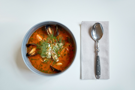 seafood soup with fish and blue mussels in bowl