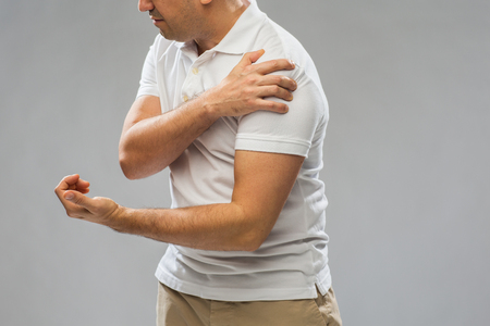 middle joint: close up of man suffering from pain in hand