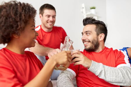 happy football fans or friends with beer at home