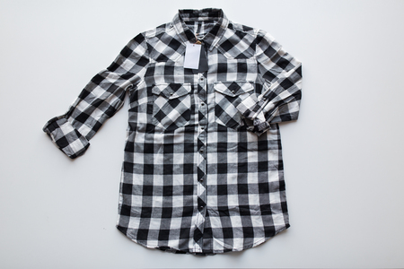 checkered shirt with price tag on white background Stock Photo