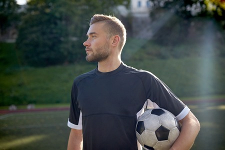 competitive sport: soccer player with ball on football field Stock Photo