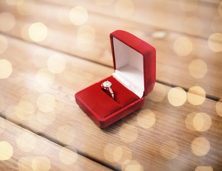 attentions: close up of gift box with diamond engagement ring