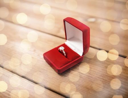 uprzejmości: close up of gift box with diamond engagement ring