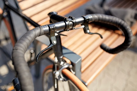 transport and vehicle concept - close up of fixed gear bicycle on street