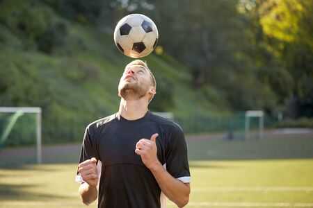 football play: soccer player playing with ball on field