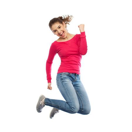 over white: happiness, freedom, motion and people concept - smiling young woman jumping in air over white background Stock Photo