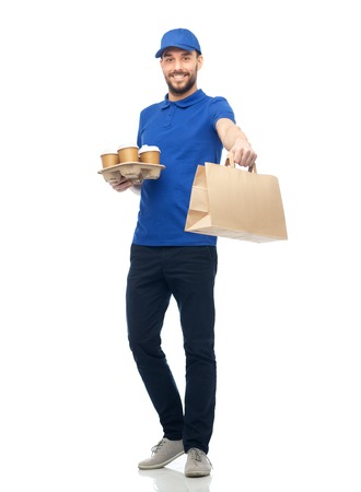 deliveryman: happy delivery man with coffee and food in bag Stock Photo