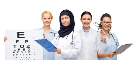 glasses eye: doctors with clipboards, eye chart and glasses Stock Photo