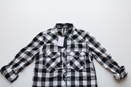 close up of checkered shirt on white background