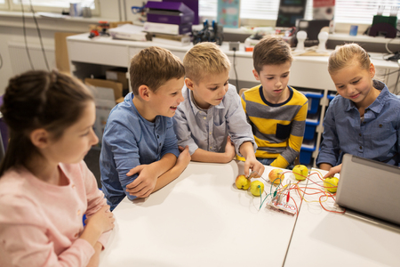 computer science: kids with invention kit at robotics school
