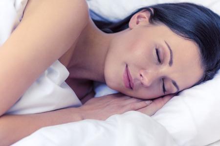 awaking: beautiful woman sleeping in bed