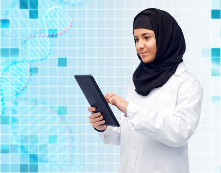 muslim female doctor in hijab with tablet pc