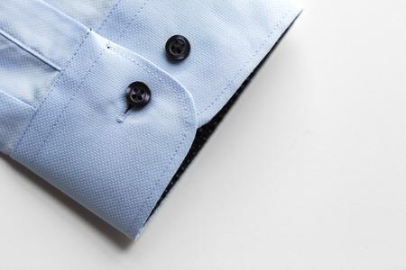 close up of blue shirt sleeve