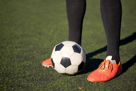 competitive sport: soccer player playing with ball on football field