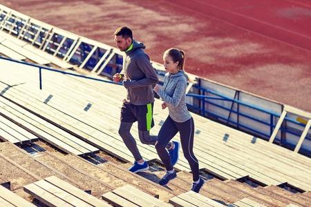 upstairs: couple running upstairs on stadium Stock Photo