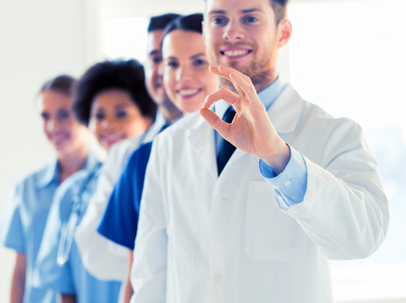 close up of doctors showing ok sign at hospital