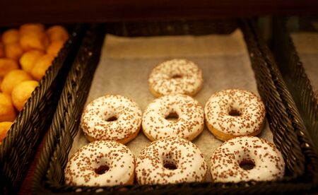 multiple objects: close up of donuts at bakery or grocery store Stock Photo