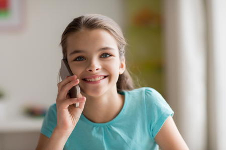 close up of girl calling on smartphone at home