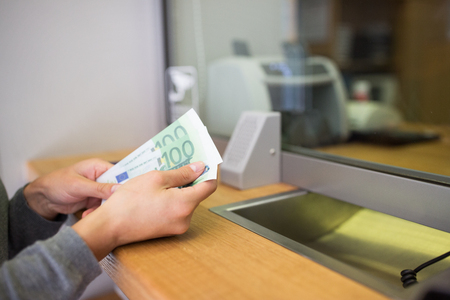 banco dinero: people, withdrawal, saving and finance concept - hands with cash money at bank office or currency exchanger