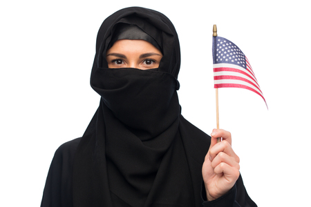 paranja: muslim woman in hijab with american flag