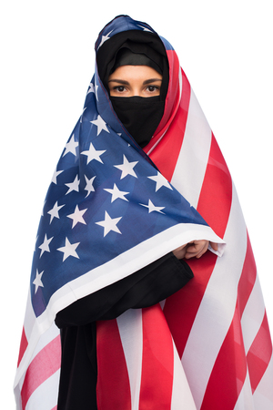 muslim woman in hijab with american flag