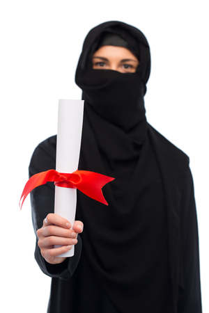 yashmak: muslim woman in hijab with diploma over white