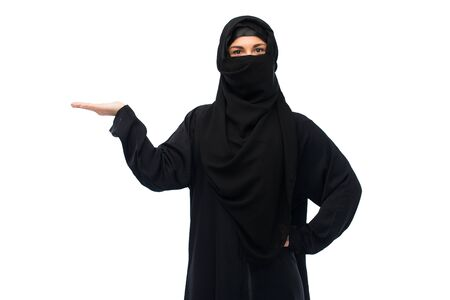 presenting: muslim woman in hijab holding empty hand Stock Photo
