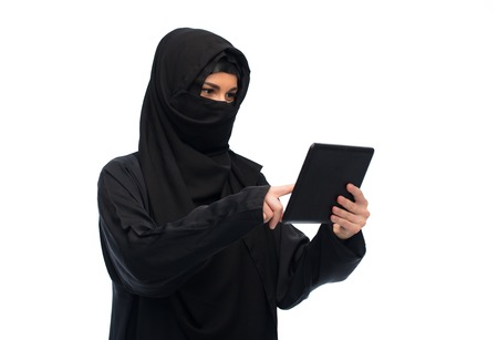 paranja: muslim woman in hijab with tablet pc computer Stock Photo