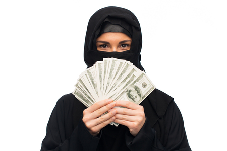 arabic currency: muslim woman in hijab with money over white